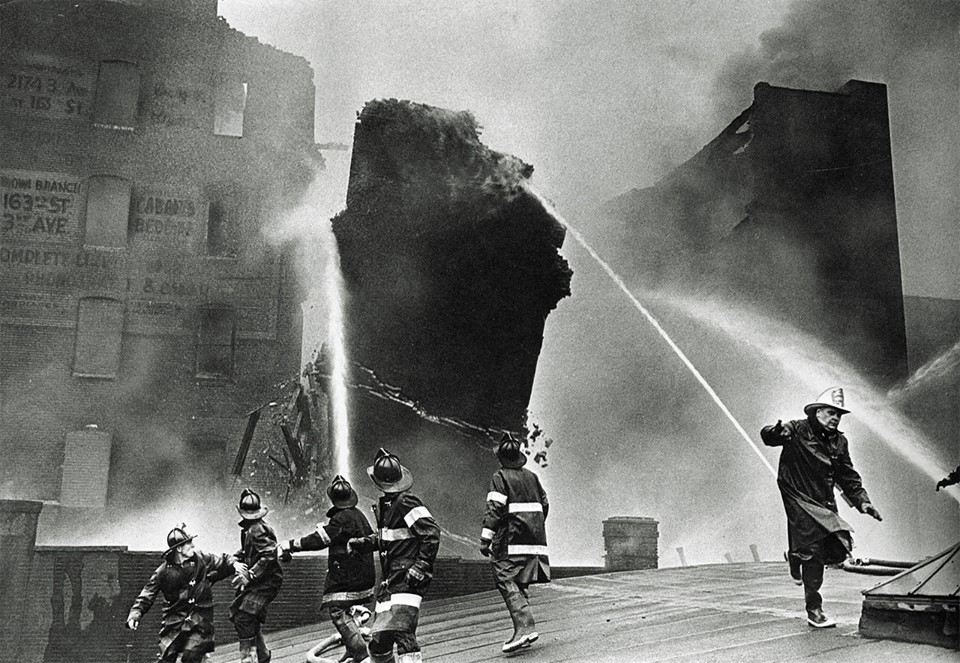Photo:  Firemen Fleeing a Falling Wall.  July 1962.  By Neal Boenzi.